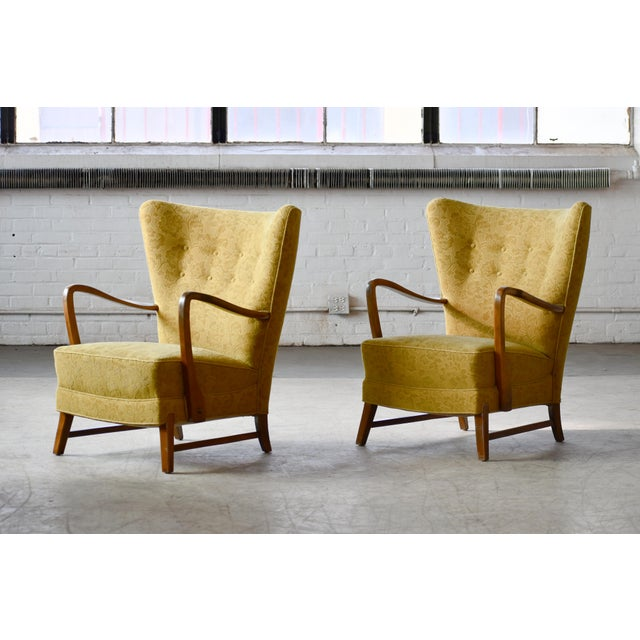 Classic Danish very comfortable high back armchair from the 1940s in the style of Fritz Hansen and Alfred Christensen with...