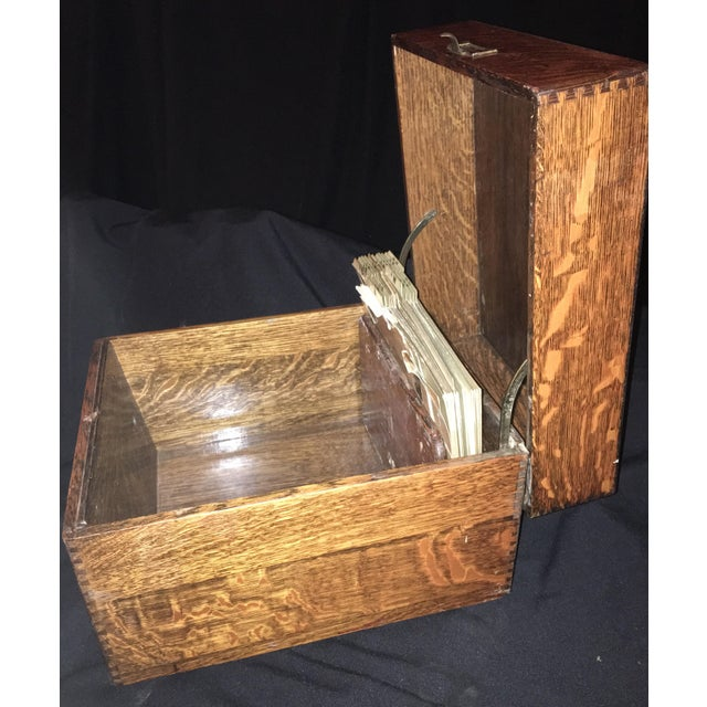 A beautiful flamed oak filing box with dovetail joints and a hinged lid. Made in the 1920s.