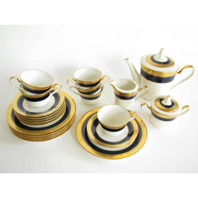Stunning and rare vintage Noritake fine china tea set with cobalt blue band and gold encrusted rim. Set includes a teapot,...