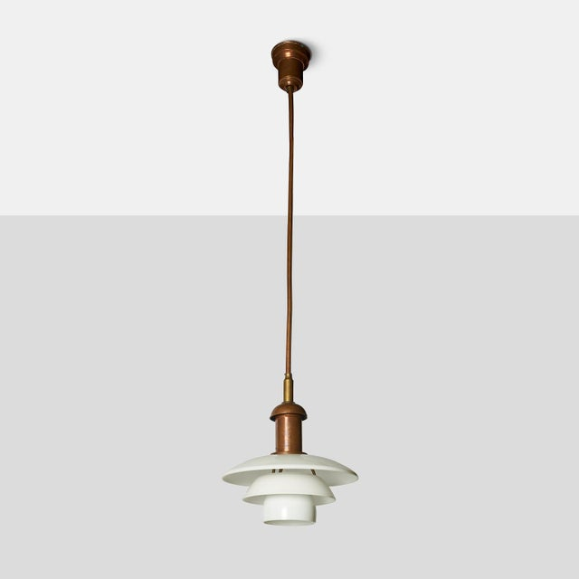 Copper Pendant by Poul Henningsen A very rare copper hanging lamp with fixed ceiling rod by Poul Henningsen for Louis...