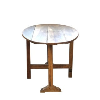 19th Century French Oval Wine Tasting Table With Tilt-Top and H-Form Trestle Base For Sale