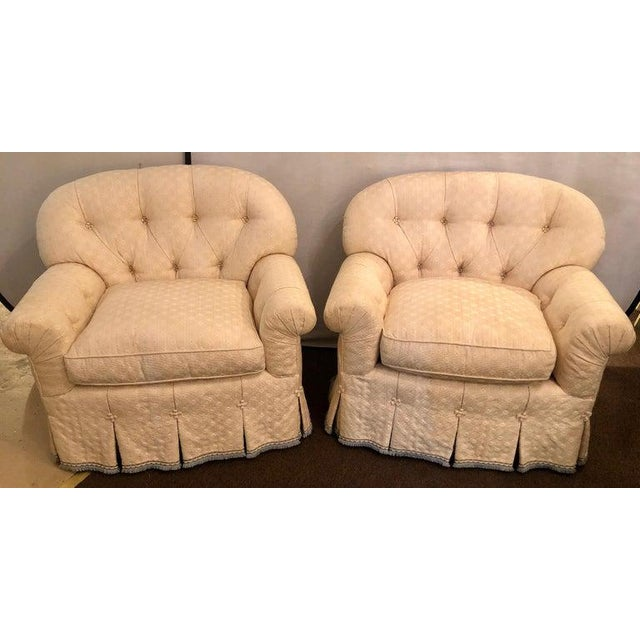 Hollywood Regency style abounds in this finest pair of lined and pleated spectacular overstuffed boudoir or lounge chairs...
