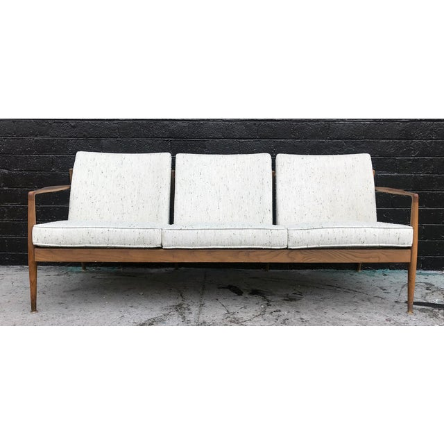 An absolutely stunning sofa with brand new fresh upholstery in a new old stock nubby cream colored fabric with green...