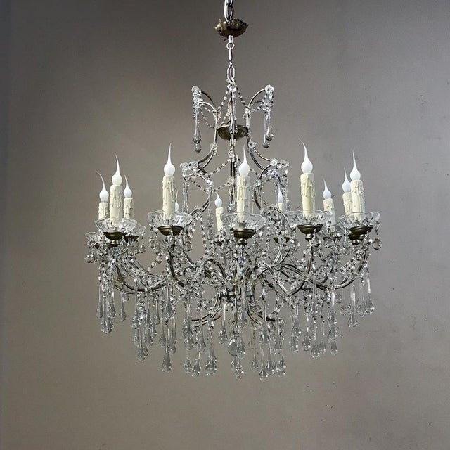 Antique Bronze and Crystal Chandelier is perfect for providing incredible ambiance with the shimmer of the crystals...