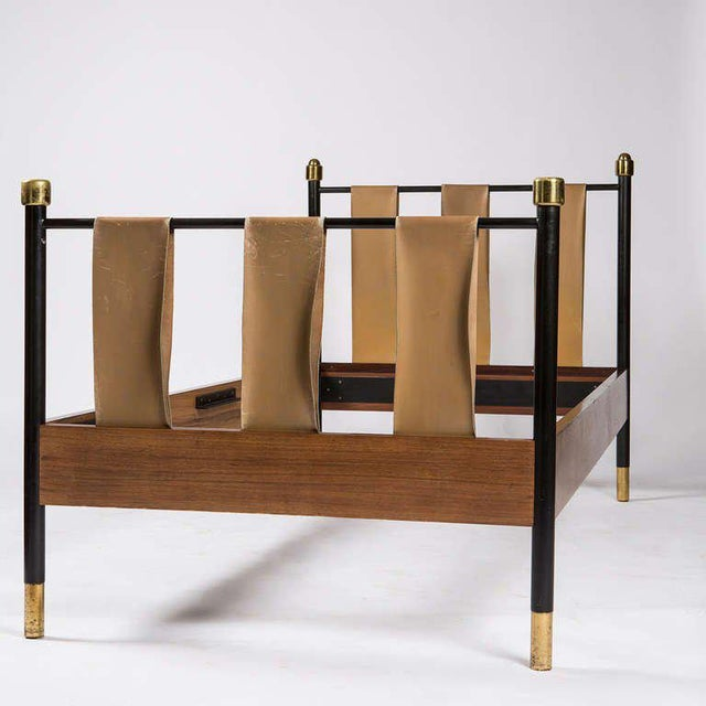 Beautiful Italian single bed. Brown leather stripes, lacquered metal frame and brass details. Shapes and combination of...