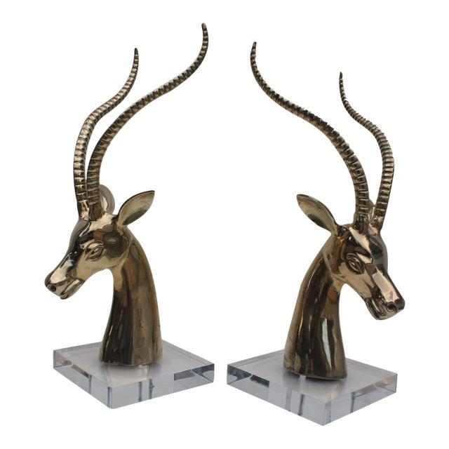 Hollywood Regency Ibex Brass on Lucite Base Sculptures - A Pair For Sale