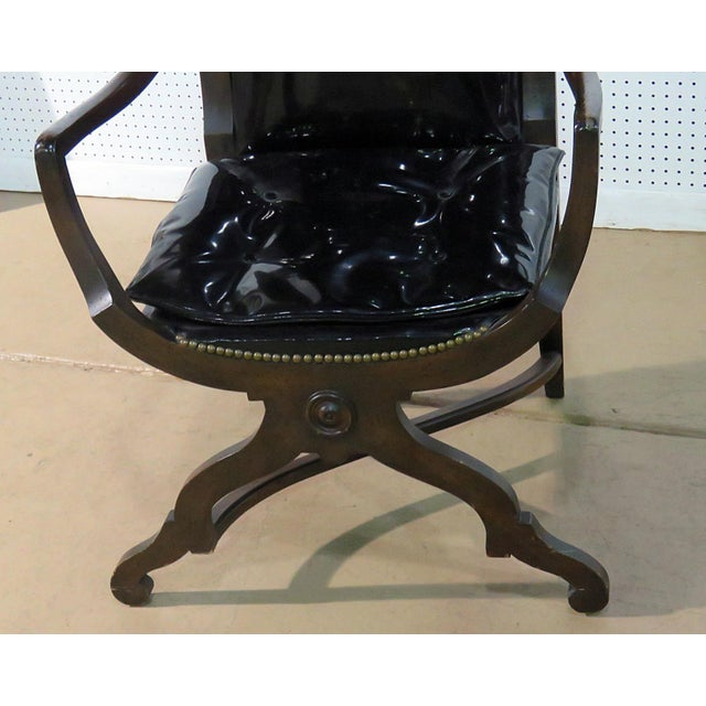 Mid-20th Century Martin Industries distressed finished porters chair with black vinyl upholstery and nail head trim.