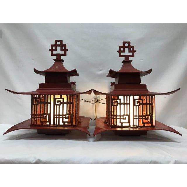 Fantastic pair of Asian outdoor lighting came from an estate as the entire estate was of this decor. Constructor of molded...