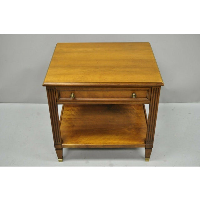 Kindel Belvedere (2332-46) French regency one drawer end table. Item features brass capped feet, solid wood construction,...