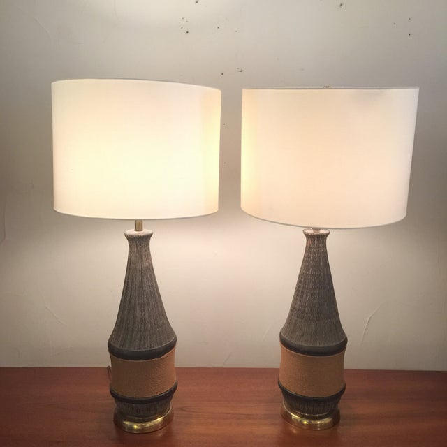 Pair of Bitossi Italy rope ceramic lamp. Dark Brown-ish textured ceramic body with lower middle part is wrapped in rope...