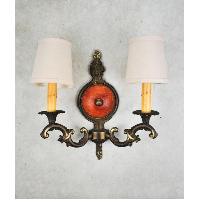 Make a dramatic statement with this pair of vintage wall sconces. The ornamental design plays up the decorative brass...