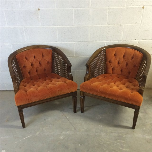 The two barrel chairs feature wooden frames, rattan caned sides, and velvet upholstery. The caning is fully intact and the...