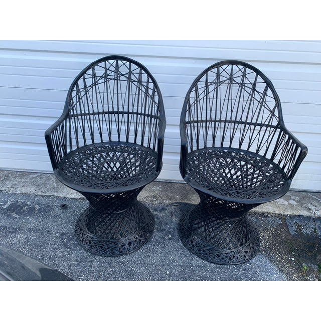 Pair of Russell Woodard fiberglass spun arm chairs. Perfect condition. Chairs have been repainted in black. Add round...