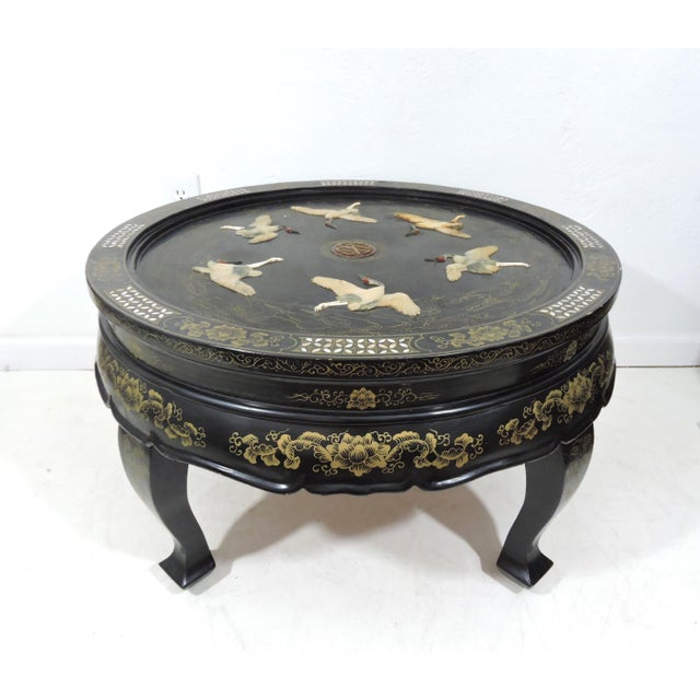 A very lovely Chinoiserie coffee table. Made in Tianjin, China around the 1950's - a round, black lacquer folding accent...