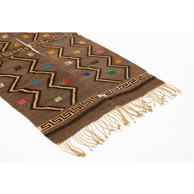 Mixtec wool serape blanket, handwoven with traditional cloud and thunder symbols. Slit opening in middle for wearing. Hand...
