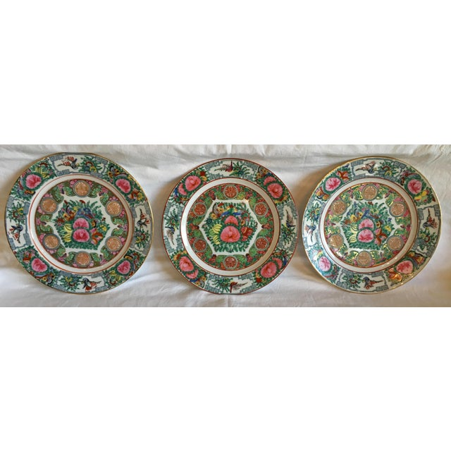 Beautiful vintage set of three hand painted Famille Rose Medallion porcelain plates. The plates compliment each other and...