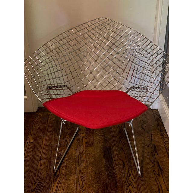 This beautiful Bertoia Lounge Chair in Chrome is in perfect condition. The seat is made from Maharam Kvadrart Red Wool....