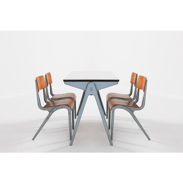 Mid-Century Modern Industrial children's furniture by James Leonard. Bent plywood seating and cast aluminum frame. UK,...