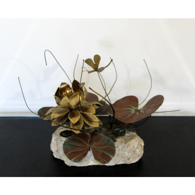 For your consideration is a gorgeous, brass water lily table sculpture, in the style of Curtis Jere, circa the 1970s. The...