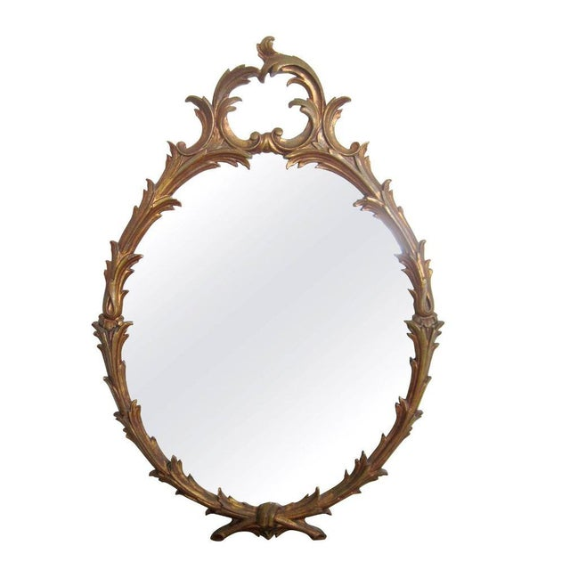 Italian Oval Gold Giltwood Carved Wall Mirror For Sale
