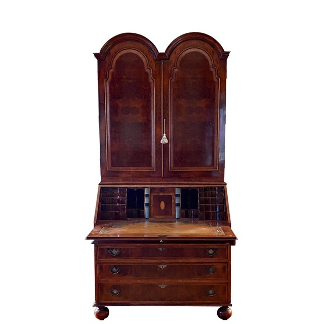 A fine English cabinet made Queen Anne Style double domed secretary bookcase. The upper case with a double domed top and...