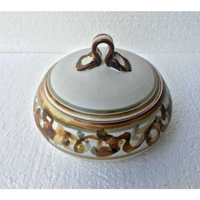 Exceptional vintage studio pottery dish with pinched handle lidded top. Decorative ribbon & striping of grey, tan, &...