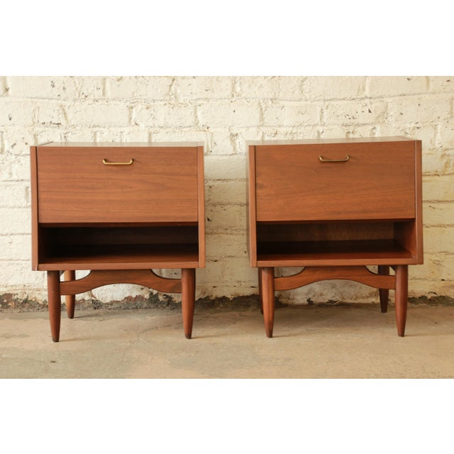 """Offering an excellent pair of Mid-Century Modern nightstands designed by Merton Gershun for the """"Dania Collection"""" by..."""