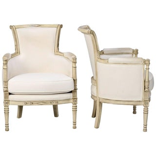 Louis XVI Style White Painted Bergeres - a Pair