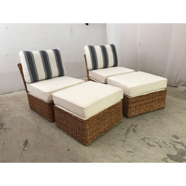 A natural woven rattan chair and ottoman set. All new seat and ottoman cushions covered in an indoor/outdoor off white...