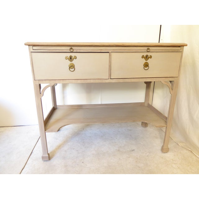 Antique Chinese Chippendale style mahogany console, painted in a taupe tone with beige top, single flap at back opens to...
