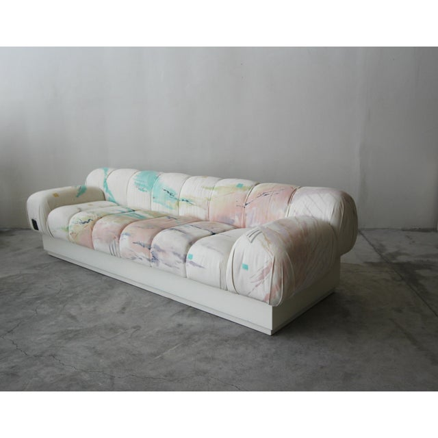 Incredible and large, post modern Italian style sofa on a plinth base. Most likely a custom piece, this beauty truly has...