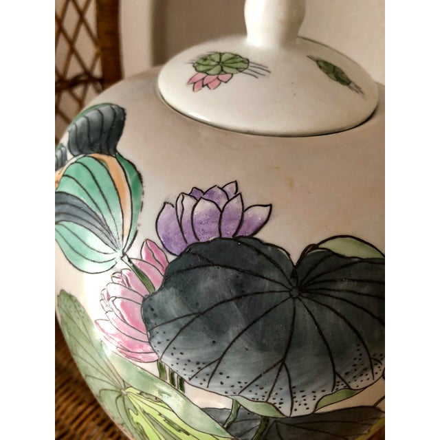 Beautifully and colorfully hand-painted ginger jar. Features water lily flowers and foliage in shades ranging from oranges...