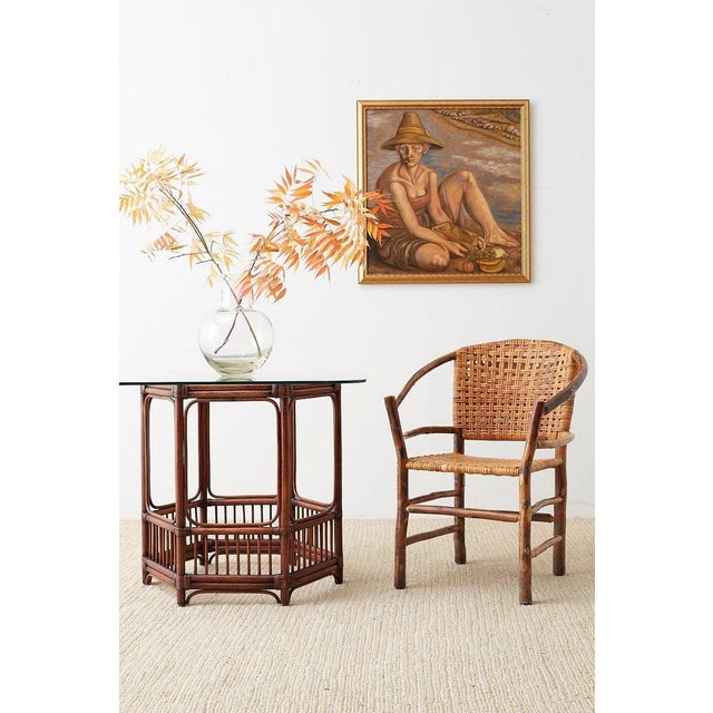 Iconic set of six rustic barrel form armchairs made in the Adirondack style by Old Hickory Furniture Company. Produced...