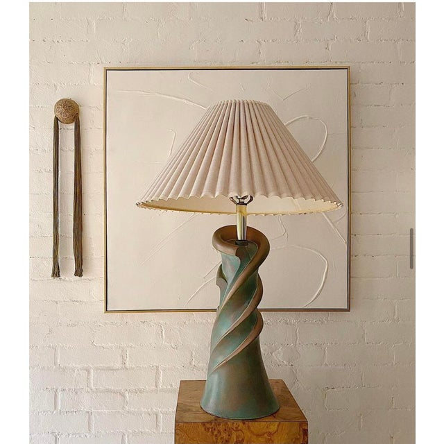 Sculptural spiral ceramic lamp with green and bronze swirls. Very good vintage condition by Masterarts Studio CA. Shade...