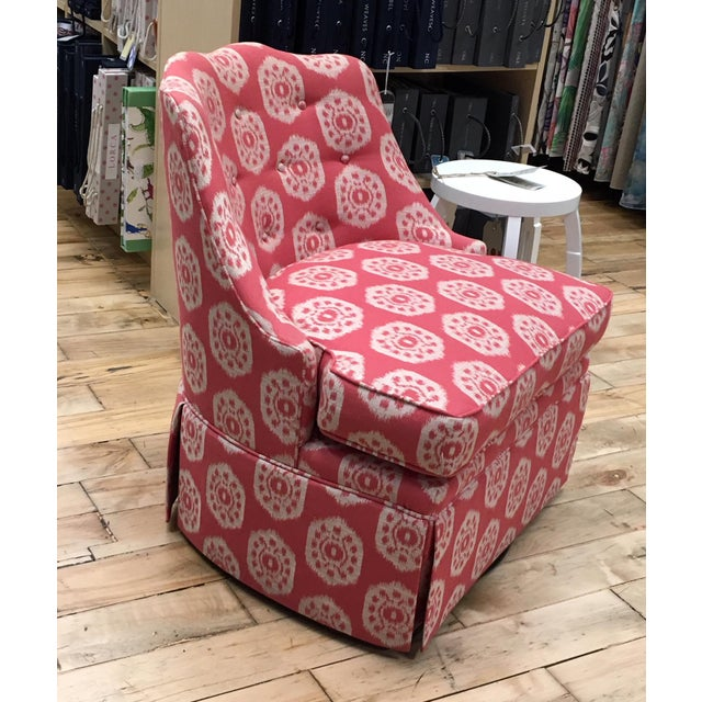Thibaut's Brentwood swivel chair covered in Thibaut's fabric Circle Ikat colorway raspberry red. This is a comfortable,...