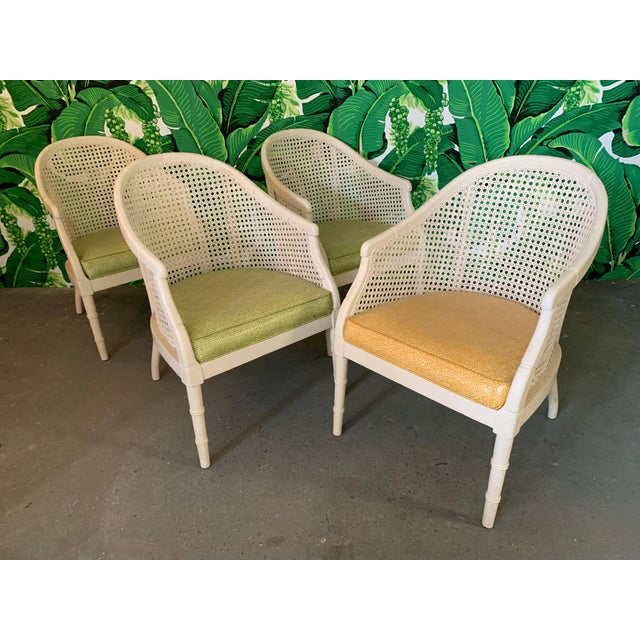 Set of 4 barrel chairs feature cane backs and vinyl upholstery in a fun vintage print. One chair in yellow vinyl and three...