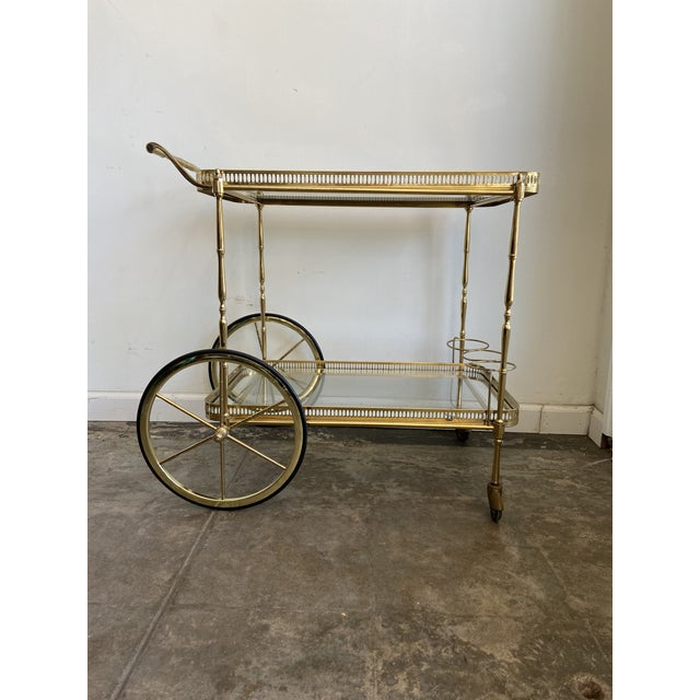 This divine vintage brass and glass bar cart works beautifully as a side table too! Comes with a removable tray that has...