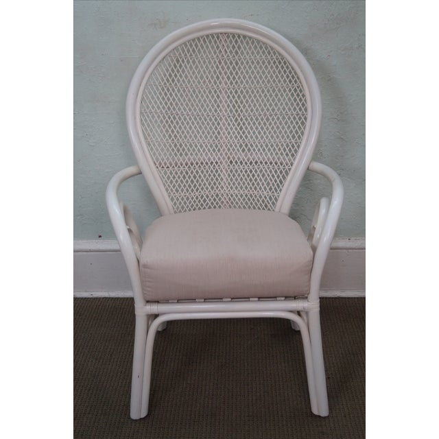 Surfside Casual vintage white painted bent bamboo and rattan fan-back armchair with upholstered seat cushion....