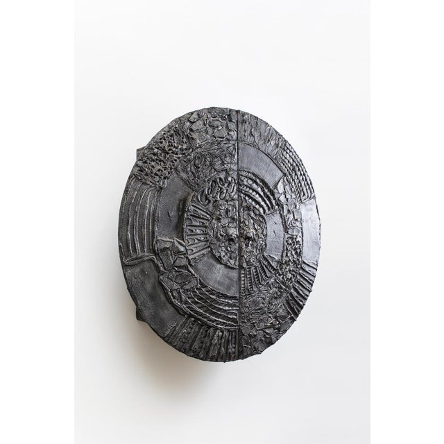 A dynamically hand-sculpted, wall-mounted sculpture cabinet, the Paul Evans Disc Bar, is arguably one of Evans' most...