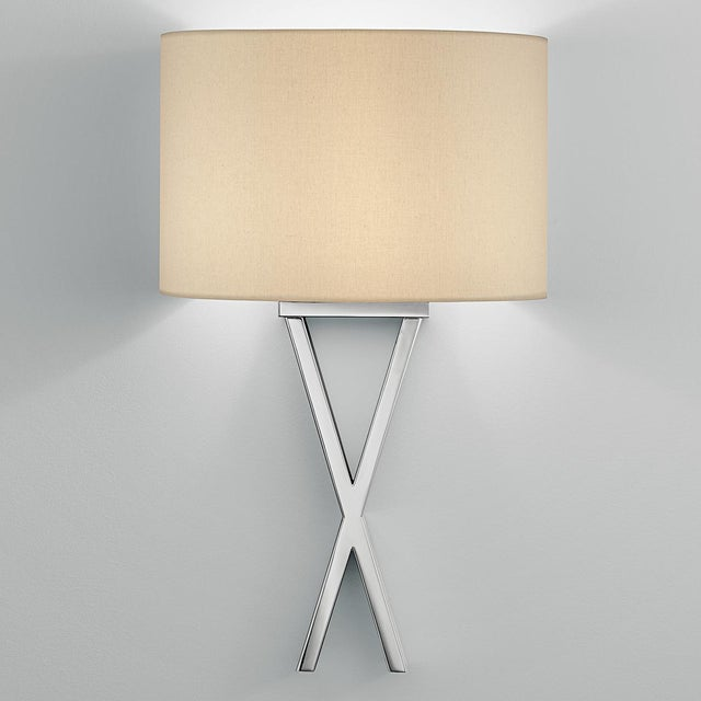 """Polished Chrome wall light. Crossover sections pass one in front of the other. Width: 30cm (11.8"""") Depth: 15cm (5.9"""")..."""