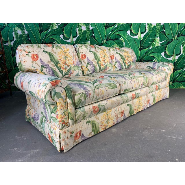 Pair of matching floral upholstered sofas by Robb & Stucky. Very comfortable and a striking print that makes a statement....