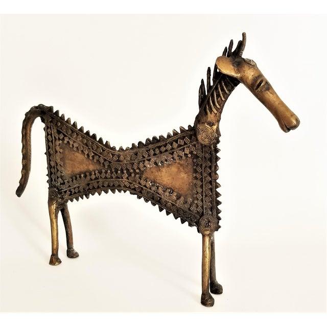 Offering a unique vintage Mid Century Modern solid brass brutalist horse sculpture, circa 1960s. This sculpture is...
