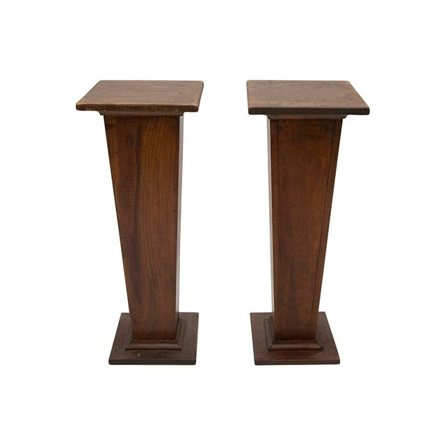 A pair of hand made wooden pedestals from the early 1900's. Hand crafted by the original owner to complete their mantle in...