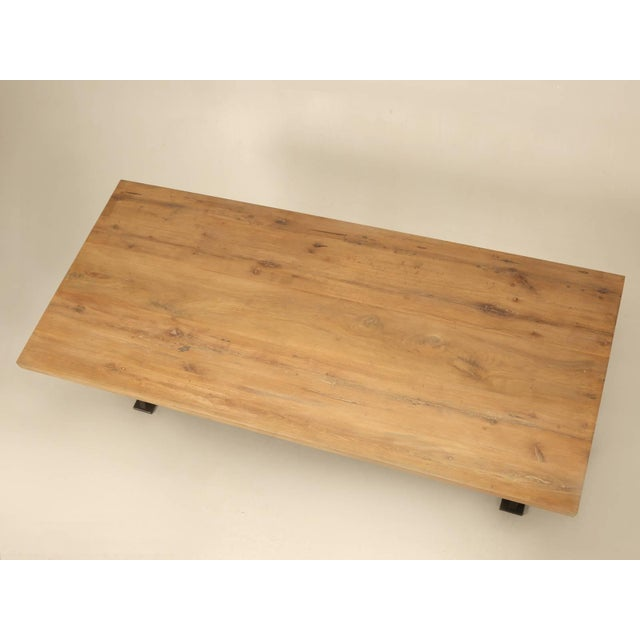 Industrial inspired steel and reclaimed white oak dining or kitchen table, built to your specifications. The table as...