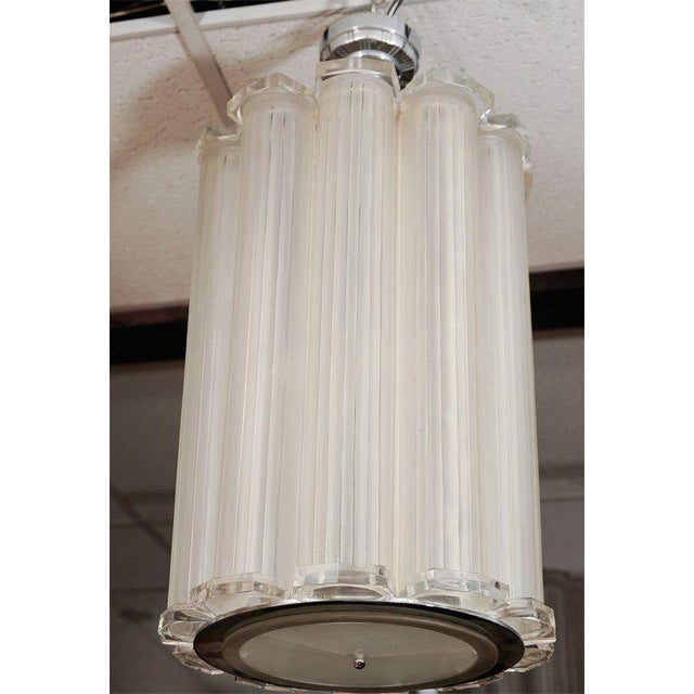 Sabino (Attributed.) French Art Deco chandelier, circa 1930. Clear and frosted glass semi-cylindrical shades mounted in a...