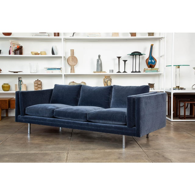 A classic sofa by Milo Baughman for Thayer Coggin. The sofa has been reupholstered in a elegant navy blue Italian cotton...