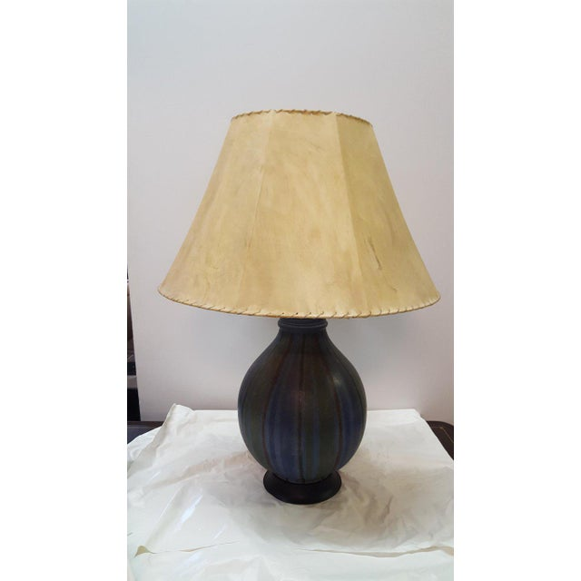 A painted strie ceramic table lamp from the 1950s. Unknown origin. Unique coloration, strie technique, and ribbed neck....