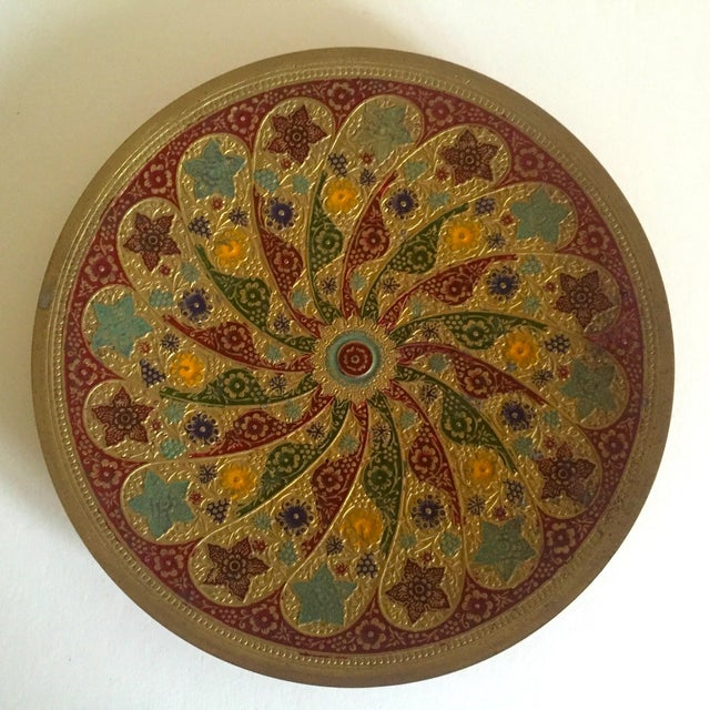 This vintage brass enamel relief Moroccan round decorative tray platter is a very special and unique piece to add to your...