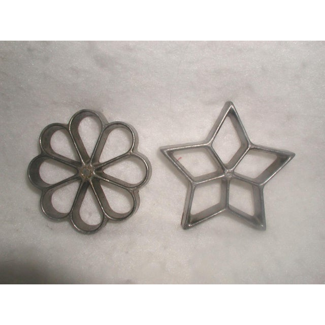 Vintage metal rosette and star molds for making deep fried dessert pastry shells. Removable heads which can be used...