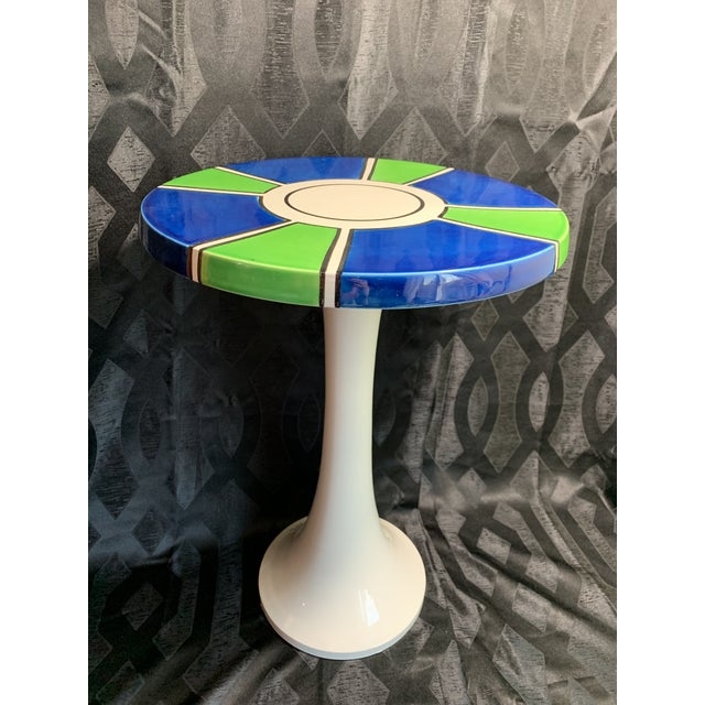 """Offered here is an iconic mid century modern """"tulip shape"""" pottery side table. The all white ceramic pottery table..."""
